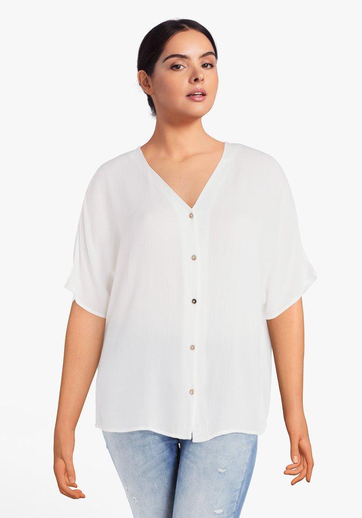 Witte blouse met knopenlijst