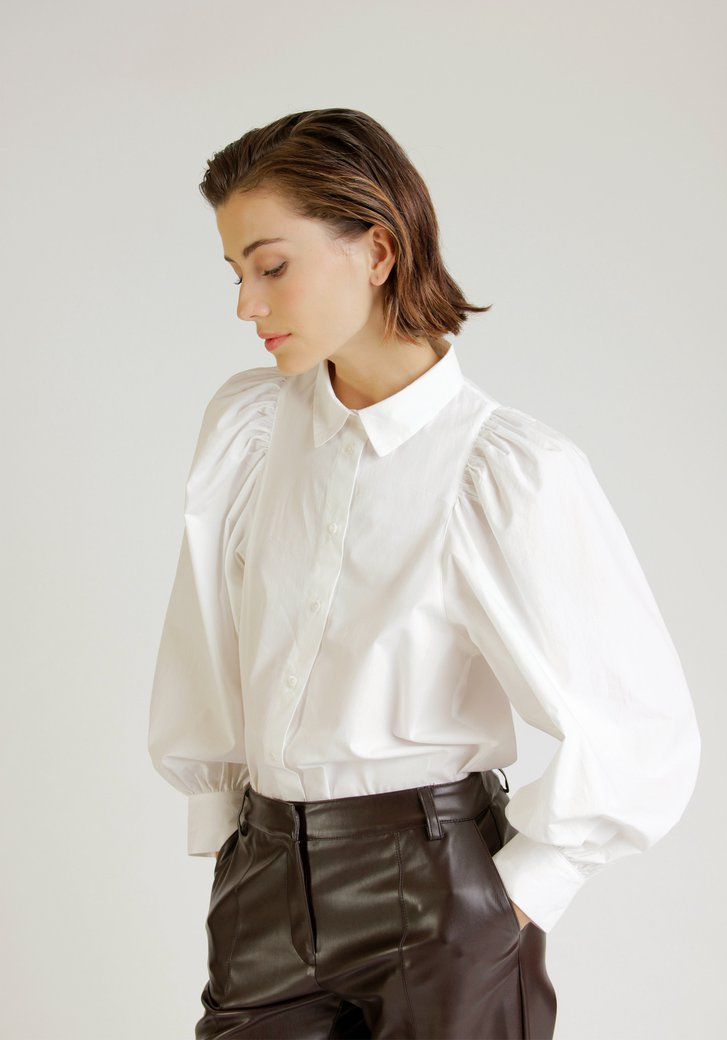 Witte blouse met statement mouwen