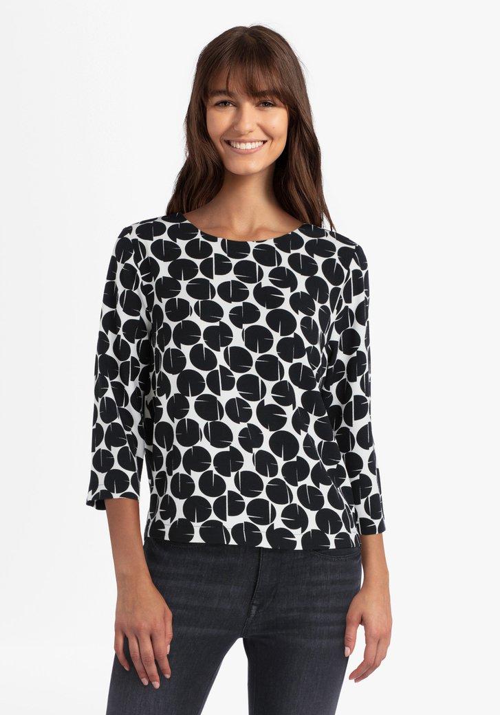 Witte blouse met zwart patroon