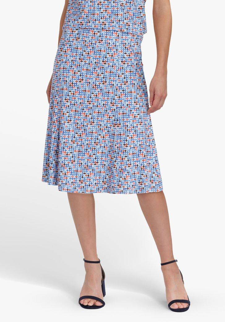 Witte rok met blauwe print en oranje accent