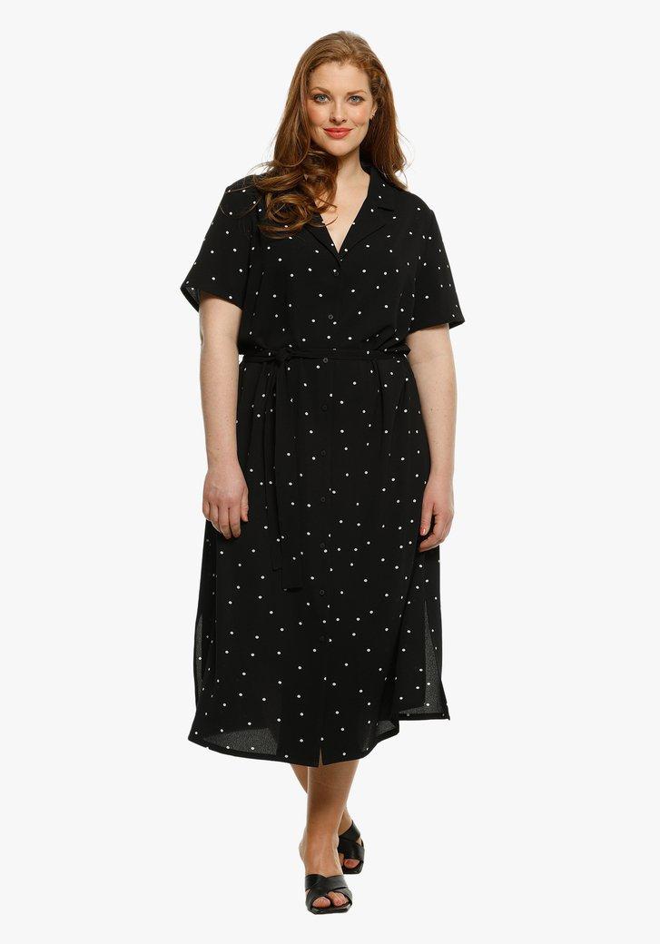 Zwart kleed met witte stippen