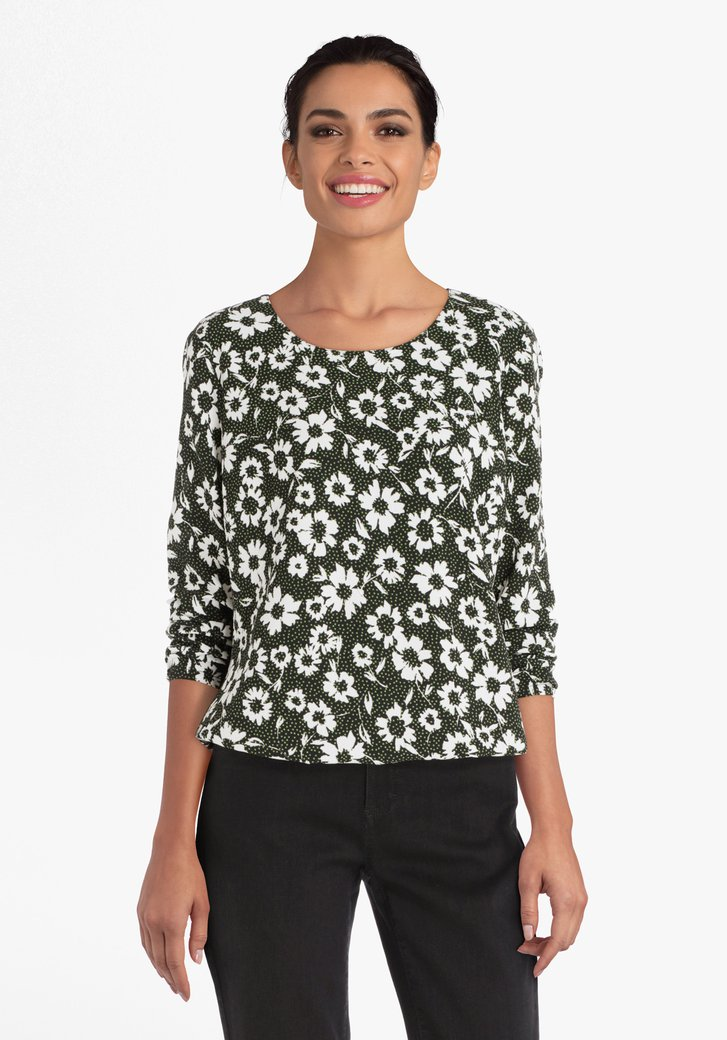 Zwarte blouse met witte bloemen en groene stippen